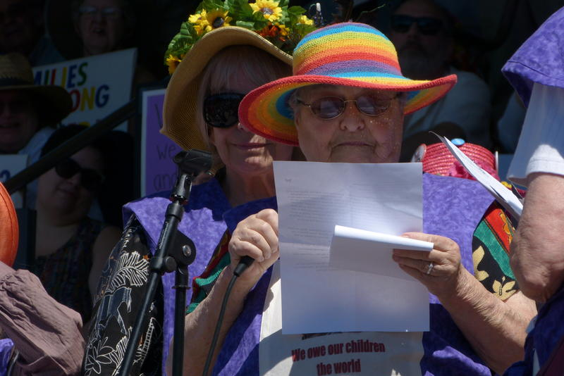 "The ""raging grannies"" read a statement and sang refugee-themed lullabies to open the rally."