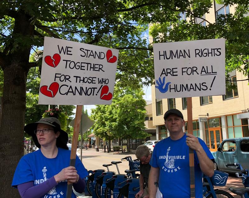 People protest U.S. immigration policies Thursday in Eugene.