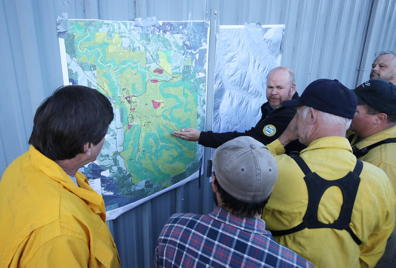 Fire officials plan the attach on the Silver Creek Fire.