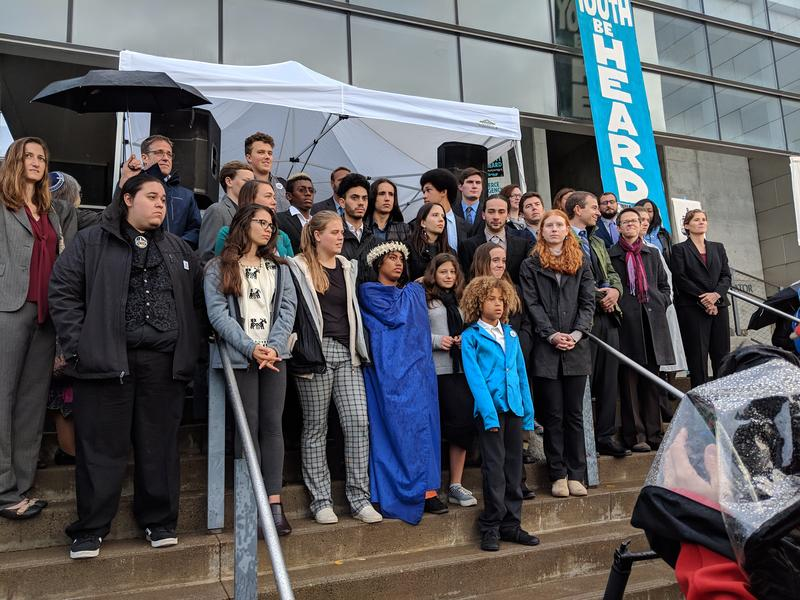 Almost all the 21 young people suing the government were part of the rally at the Eugene Federal Courthouse Monday.