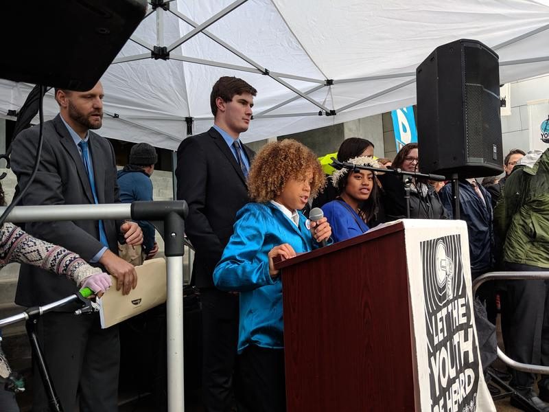 Levi Draheim, 11, addresses the crowd at the rally at the Eugene Federal Courthouse.