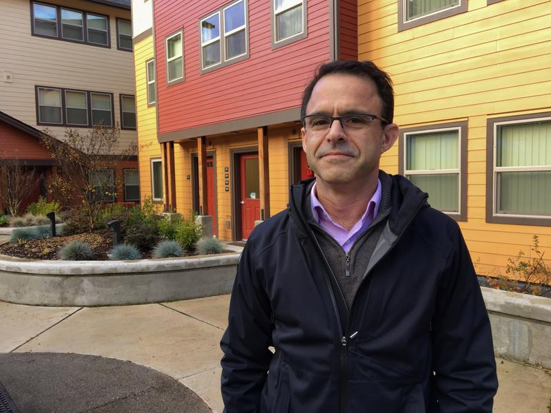 Paul Solomon stands in front of the Oaks at 14th apartment complex. The complex offers both housing and support for people recently released from jail or prison.