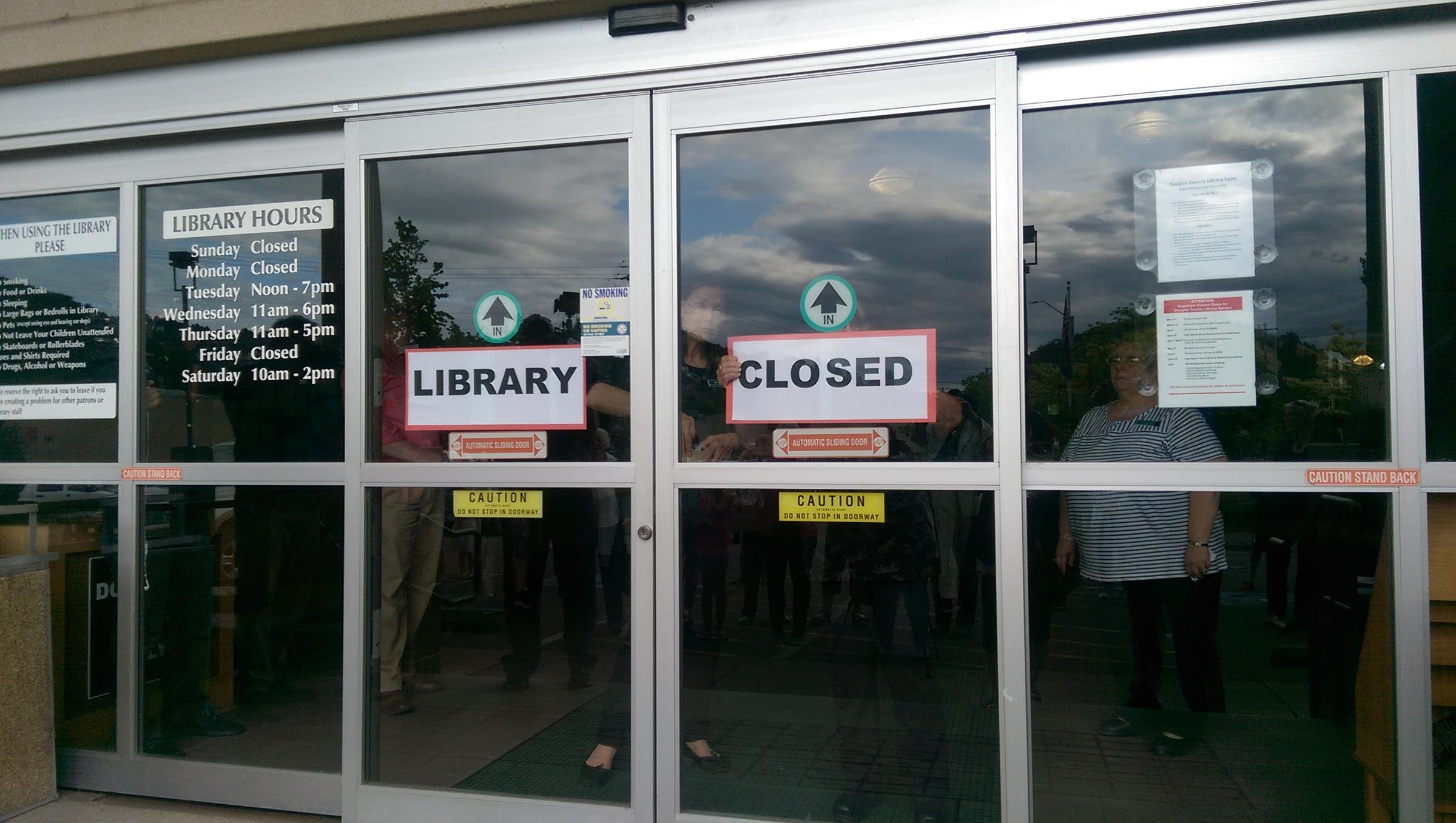 Staff placed closed signs on the doors of the Roseburg Library. & Roseburg Library Closes Its Doors | KLCC