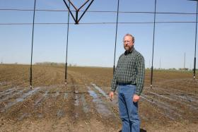 Texan Wesley Spurlock grows corn. He has replaced some of his sprinklers with water efficient nozzling systems to help conserve water from the Ogallala Aquifer.