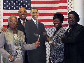 District 4 Democratic Congressional candidate Richard Tillman and supporters pose with a cardboard cutout of President Barack Obama.