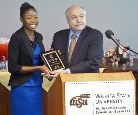 Kiah Danielle Duggins and Doug Hensler, dean of the W. Frank Barton School of Business at Wichita State.