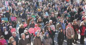 The rally attracted more than 1,000 people to the Statehouse grounds.