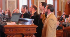Lawmakers are sworn in on the first day of the 2013 legislative session.
