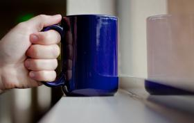 The handle on this blue coffee mug is an example of an affordance.  Its design makes obvious the purpose or function.