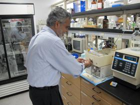 Dr. Kandatege Wimalesena works in his lab at Wichita State University.