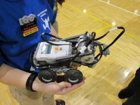 Participant Levi Kelton shows off his entry to the WSU Mindstorms robotics competition.