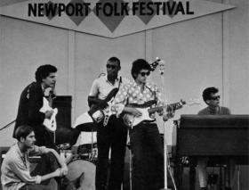 Al Kooper on organ with Bob Dylan at the famed Newport Folk Festival appearance.
