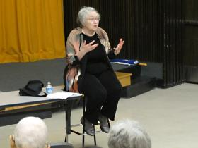 Mary Catherine Bateson speaking in front of a crowd at Wichita State University.