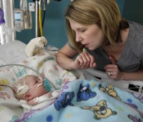 Gina Julian talks to her daughter, Ashlyn, after her surgery.