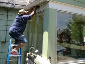 Ernest Tolon makes minor repairs to a Wichita home to increase its energy efficiency.