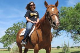 Amanda Conner with Sis, an American quarter horse.