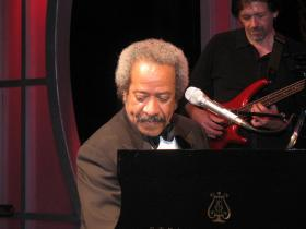 Allen Toussaint at the piano on stage at the Roosevelt Hotel, New Orleans.