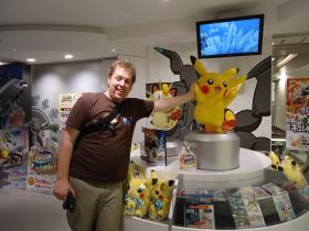 Sam McConnell high-fives Pikachu at Osaka Pokémon Center on May 6, 2012.