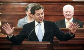 Kansas Gov. Sam Brownback delivers his State of the State address, Wednesday, Jan. 15, 2014, in the House of Representatives in Topeka, Kan.