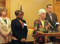 Insurance Commissioner Sandy Praeger joined representatives of AARP and other consumer groups at a Statehouse press conference urging Gov. Sam Brownback to veto a bill aimed at freeing Kansas and other states from federal Medicare and Medicaid regulations. Praeger said if Brownback signs the bill it could be a bad political move given the popularity of the Medicare program with Kansas seniors.