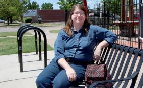 Karen Cravens, president of the Delano Neighborhood Association, at the bus stop in Delano.