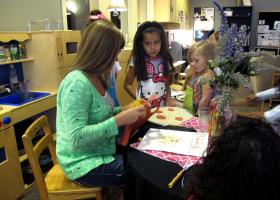 Preschool teacher Tiffany Denton speaks with students during class. Denton has worked at TOP for 8 years.