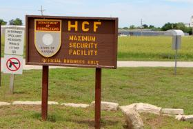 This sign is posted across the street from Hutchinson Correctional Facility's wild horse program.