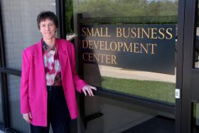 Regional Director Marcia Stevens stands outside of the Kansas Small Business Development Center on the campus of Wichita State University.
