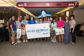 Family and friends gather at Wichita's Mid-Continent Airport to send off Craig Lehman on his Make a Wish adventure.