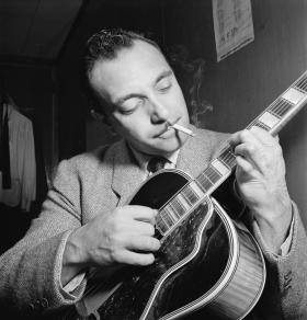 Guitarist Django Reinhardt co-founded the jazz group Hot Club of France in 1934.