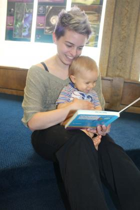 Britten Kuckelman reads to her baby Bryce in The Baby Bookworms Program