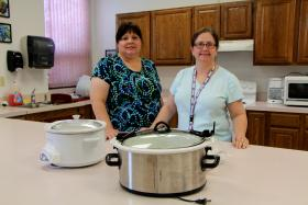 Denise Dias, left, and Jan McMahon are nutrition education agents for the Expanded Food and Nutrition Education Program at the Sedgwick County Extension office, which is affiliated with Kansas State University.