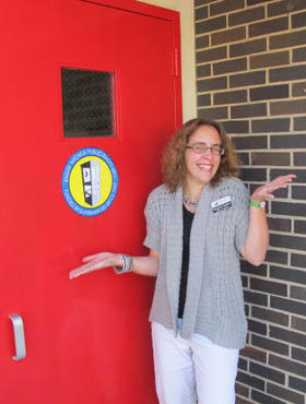 Stubblefielder Elizabeth Tackett poses with her adopted item, the Red Door
