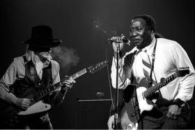 August featured artist Johnny Winter with blues man Muddy Waters