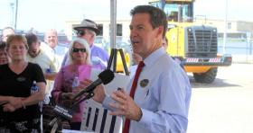 Governor Brownback speaking at an event in Topeka.