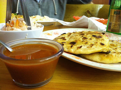 Pupusas with pickled cabbage and sauce