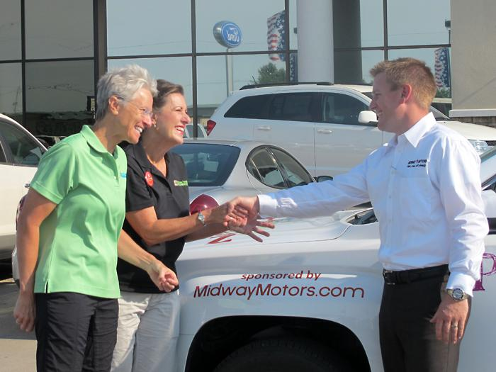 Marci Penner and WenDee LaPlant thank VP Cory Hoover of Midway Motors for loaning them the vehicle.