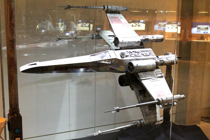 A model of an X-Wing fighter jet.