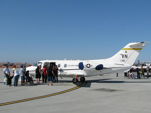 Passengers wait to board a Raytheon Hawker Beechcraft T-1 Jayhawk.