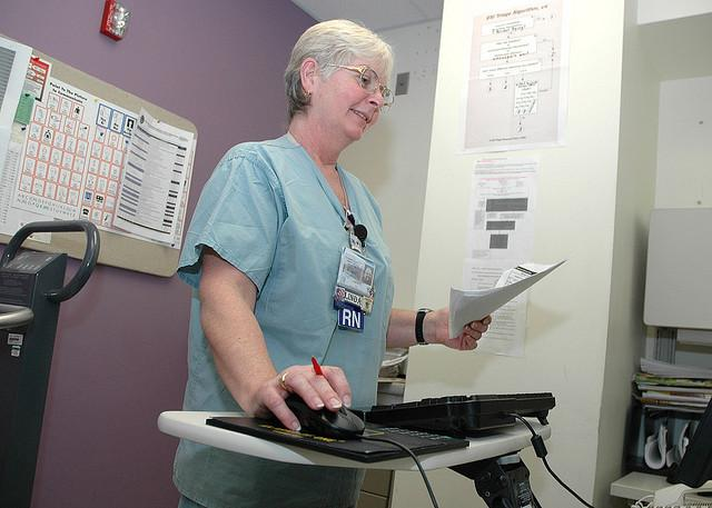 A RN uses electronic medical records.