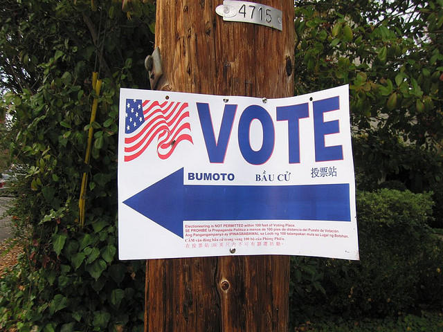 A sign directs voters to the polls.
