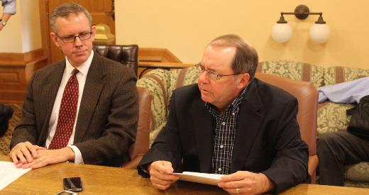 Representative Paul Davis (left, D-Lawrence) and Senator Anthony Hensley (D-Topeka) talk to reporters.