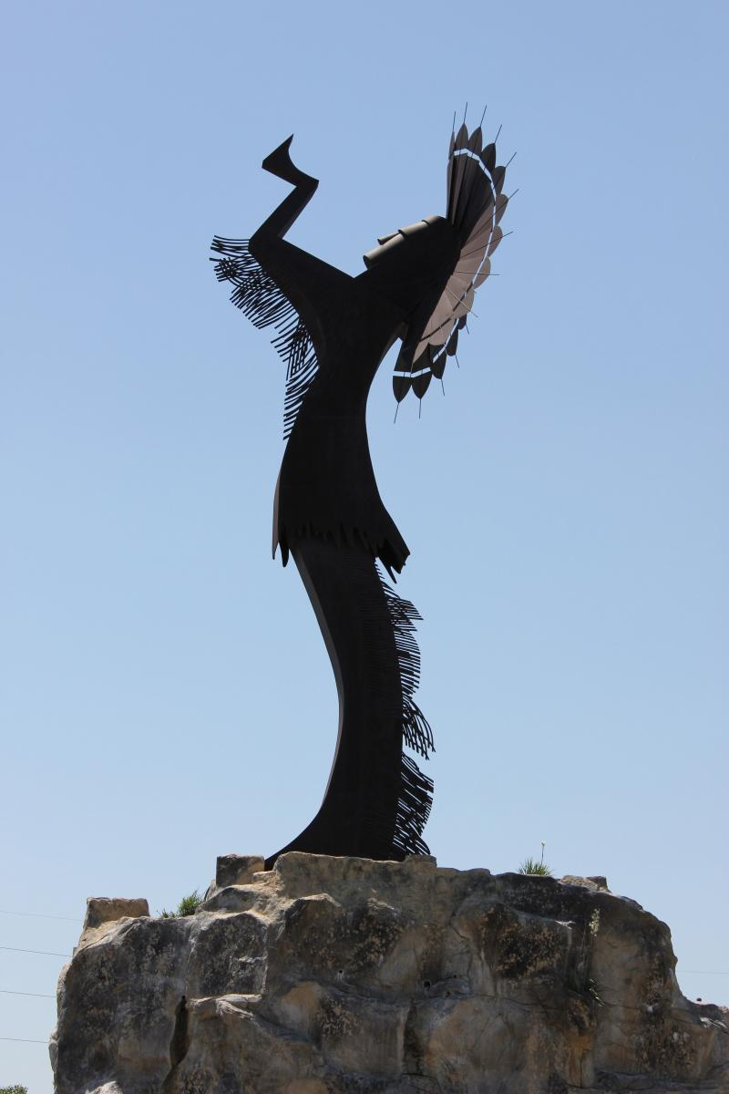 The Keeper of the Plains is a monumental sculpture that marks the confluence of the Big and Little Arkansas Rivers.