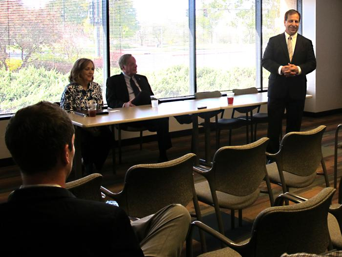 Kansas Secretary Pat George (standing,) Labor Secretary Karin Brownlee and Revenue Secretary Nick Jordan discuss tax reform with small business owners at the Wichita Metro Chamber of Commerce.
