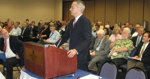 Blue Cross Blue Shield of Kansas executive Matt All addresses a recent Essential Health Benefits hearing in Topeka.