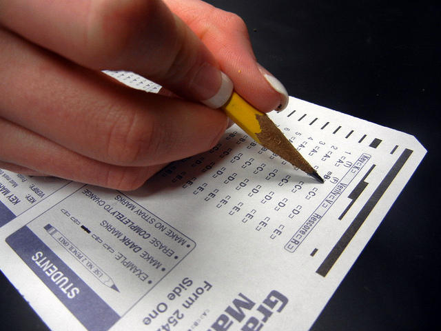A student fills out answers on a standardized test form.