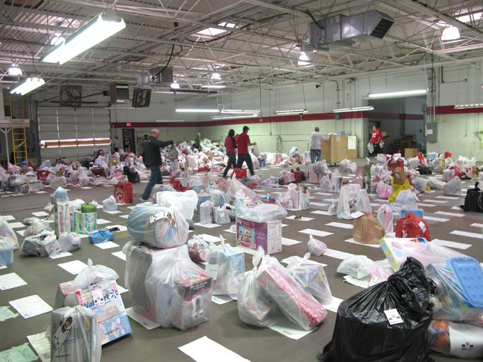 Volunteers work to match donated toys to wish lists.