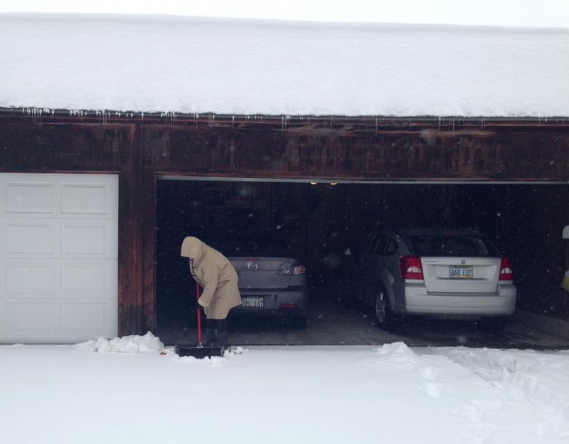 Kristi King shovels her driveway Thursday amidst one of the biggest snowstorms in Wichita history.