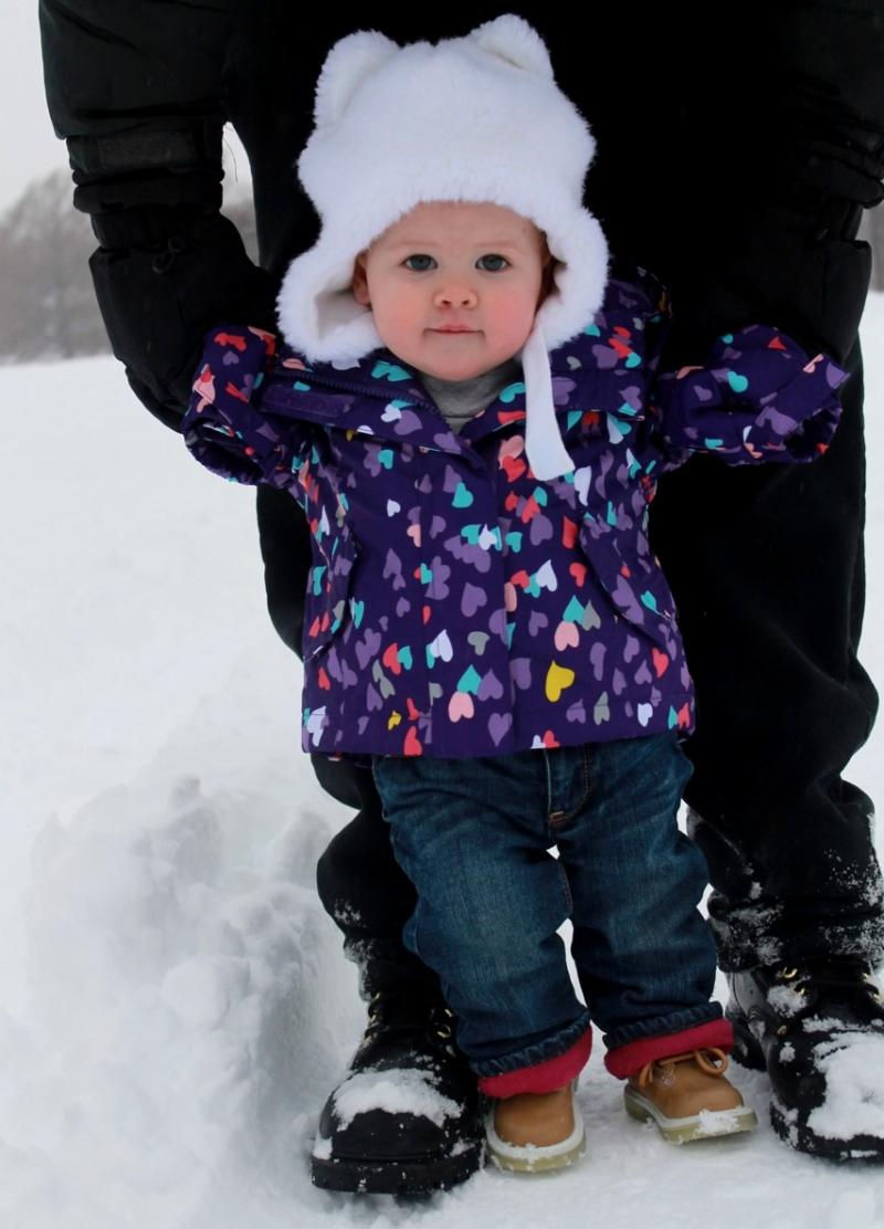 Reporter Briana O'Higgins takes her daughter Olive out to see her first snowstorm.
