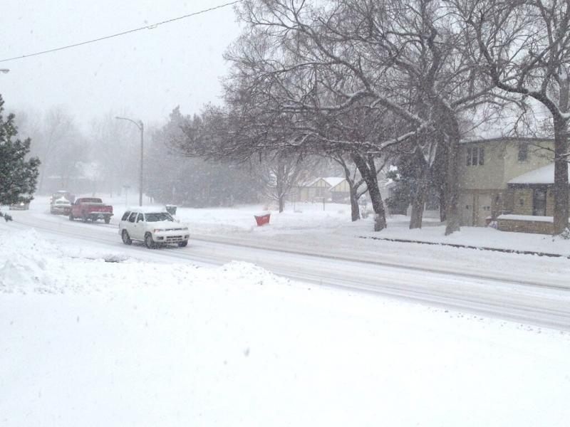 Snow starts to come down again in the Riverside neighborhood on Thursday afternoon.